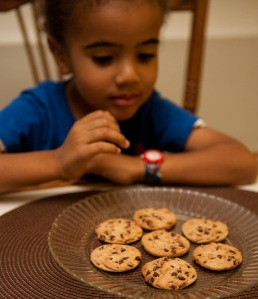 Little boy trying to choose a cookie
