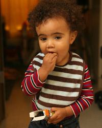 Little boy eating raising