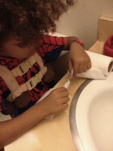 Boy tearing toilet paper
